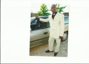 Rev. Fosu by his Car at Church premises